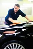 Man worker polishing car Royalty Free Stock Photography