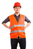 Man worker in safety vest hard hat. Safety. Young man construction worker builder foreman in orange safety vest and red hard hat isolated on white. Safety in Stock Photo