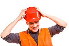 Man worker in safety vest and hard hat. Safety. Young man construction worker builder foreman in orange safety vest and red hard hat isolated on white. Safety in Royalty Free Stock Photos
