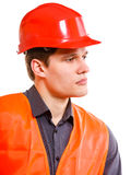 Man worker in safety vest and hard hat. Young man construction worker builder foreman in orange safety vest and red hard hat isolated on white. Safety in Stock Images