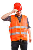 Man worker in safety vest and hard hat. Young man construction worker builder foreman in orange safety vest and red hard hat isolated on white. Safety in Royalty Free Stock Images