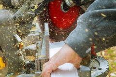 Man, worker sawing wood with a circular saw, machine for cutting. Stock Photography