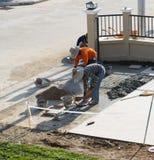 Man worker tiling ceramic floor Royalty Free Stock Photos
