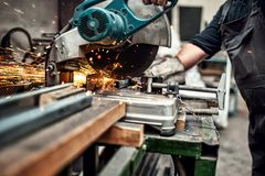 Man, Worker Using A Sliding Compound Mitre Saw Stock Images