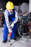 Man worker using jackhammer for work at industry Royalty Free Stock Photos