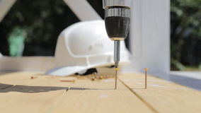The man worker using a screwdriver. Close up. Construction concept. The man worker using a screwdriver. Close up. Construction concept stock video