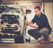Man worker washing car Royalty Free Stock Images