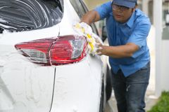 Man worker washing car`s on a car wash royalty free stock photos