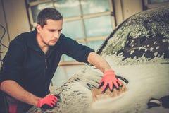 Man worker washing luxury car Royalty Free Stock Photo