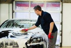Man worker washing luxury car Royalty Free Stock Images