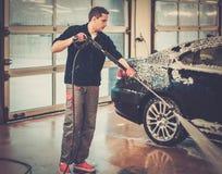 Man worker washing luxury car Royalty Free Stock Photography