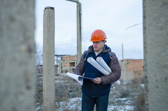 The man worker wear a orange helmet with construction site Stock Image