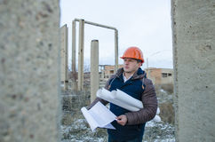 The man worker wear a orange helmet with construction site Stock Images