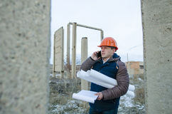 The man worker wear a orange helmet with construction site Royalty Free Stock Photos