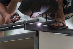 The man worker welding steel Stock Photos