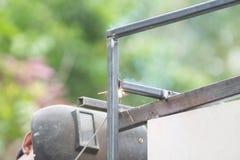 Man worker welding steel Stock Images
