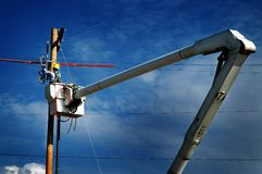 Free Man Worker Working On Power Lines Crane Bucket High In The Air Dangerous Royalty Free Stock Image - 142325136