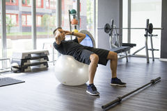 Man working abs in gym Royalty Free Stock Image