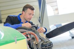 Man working on aircraft stock photography