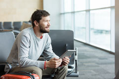 Man working at airport Stock Photography