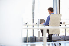 Man working alone in a modern office Stock Images