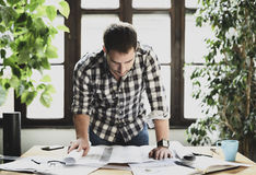 Man working on architectural project stock photography