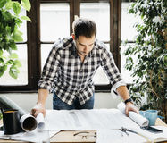 Man working on architectural project royalty free stock photos
