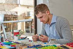 Man working as artisan in jewelry. Workshop creating a necklace Royalty Free Stock Photo