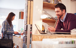 Man working behind the counter at a record shop Royalty Free Stock Photography