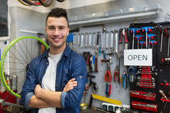 Man working in bicycle repair shop Stock Photography