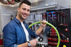 Man working in bicycle repair shop Stock Image