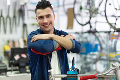 Man working in bicycle repair shop Royalty Free Stock Photography