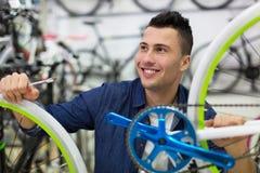 Man working in bicycle repair shop Stock Photos