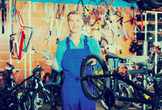 Man working with bicycles wheels Royalty Free Stock Image