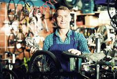 Man working with bicycles wheels Royalty Free Stock Images