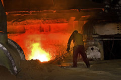 Man working on blast furnace. Royalty Free Stock Photos