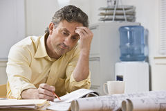 Man Working on Blueprints Stock Photos