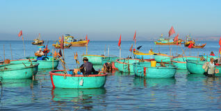 A man working on the boat in Mui Ne town, Vietnam.  Royalty Free Stock Photo