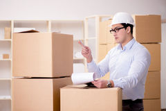 The man working in box delivery relocation service. Man working in box delivery relocation service Stock Photography