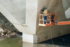 Man Working on Bridge Stock Photography