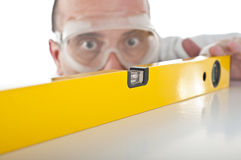 Man working with bubble level Royalty Free Stock Photography