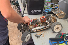 Man working on the buggy car model Stock Images