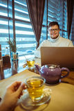 Man working in cafe Stock Image
