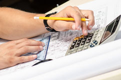 Man working with a calculator and square drawing Stock Photo