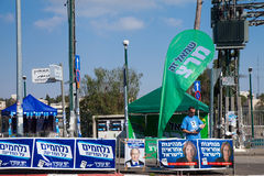 Man working on a campaign stand in Israel during elections day Stock Photo