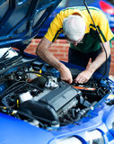 Man working on a car engine Stock Photo