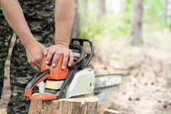 A man working a chainsaw Stock Photography