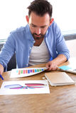 Man working on charts and graphs at his desk Royalty Free Stock Image