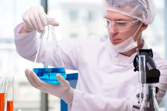 The man working in the chemical lab on science project Stock Image