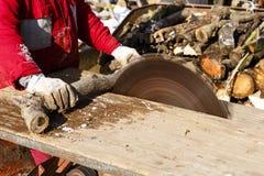 Man working with circular saw blade Stock Photos